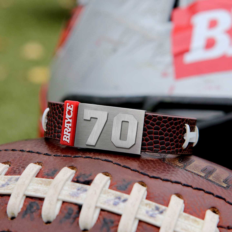 football bracelet on top of a football